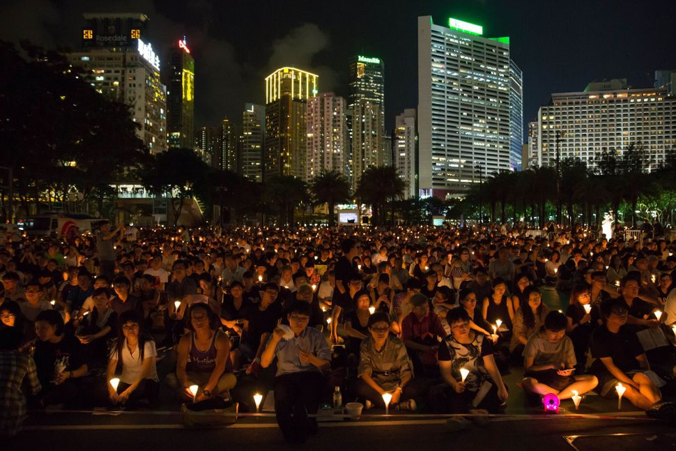 People take part in a candlelight vigil in Hong Kong on June 4, 2015, to mark the crackdown on the pro-democracy movement in