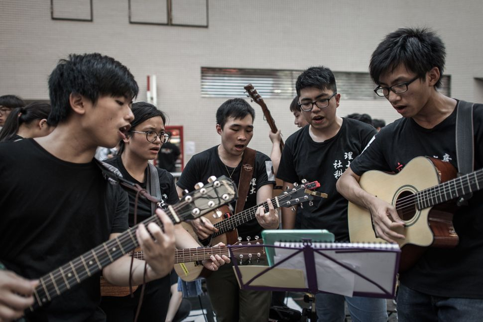 Students rehearse songs before the commemoration of China's 1989 Tiananmen Square crackdown in Hong Kong on June 4, 2015.