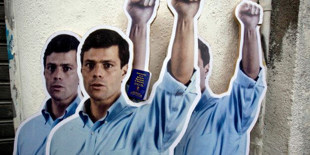 FILE - In this July 23, 2014 file photo, life-size cardboard cutouts of opposition leader Leopoldo Lopez, placed by his suppo