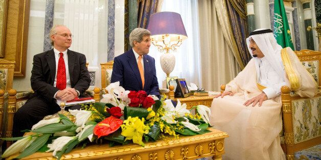 U.S. Secretary of State John Kerry, center, accompanied by Timothy Lenderking, US charge d'affaires, left, meet with Saudi