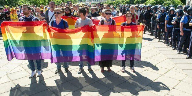 Gay activists hold the first Gay Pride march in Kiev, since fighting with pro-Moscow rebels broke out in the east of the coun