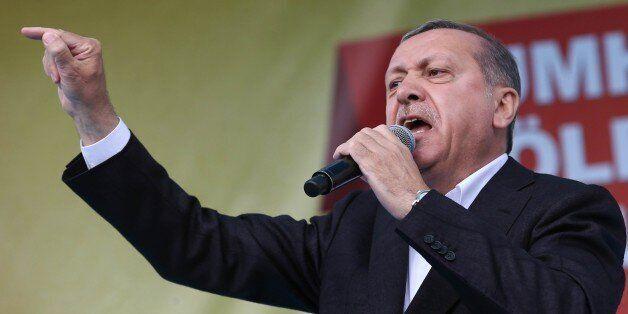 Turkish President Recep Tayyip Erdogan speaks during a rally in Golbasi district of Ankara on June 5, 2015 AFP PHOTO/ADEM ALT