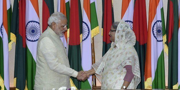 Indian Prime Minister Narendra Modi (L) shakes hand with Bangladeshi Prime Minister Sheikh Hasina Wajid (R) after their meeti