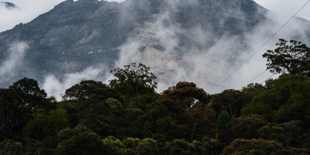 Malaysia's Mount Kinabalu is seen among mists from the Timpohon gate check point a day after the earthquake in Kundasang, a t