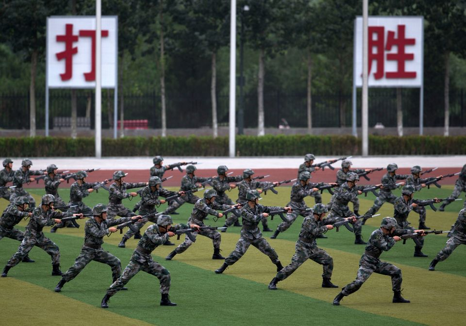 Chinese People's Liberation Army cadets take part in a bayonet drills at the PLA's Armoured Forces Engineering Academy Base,