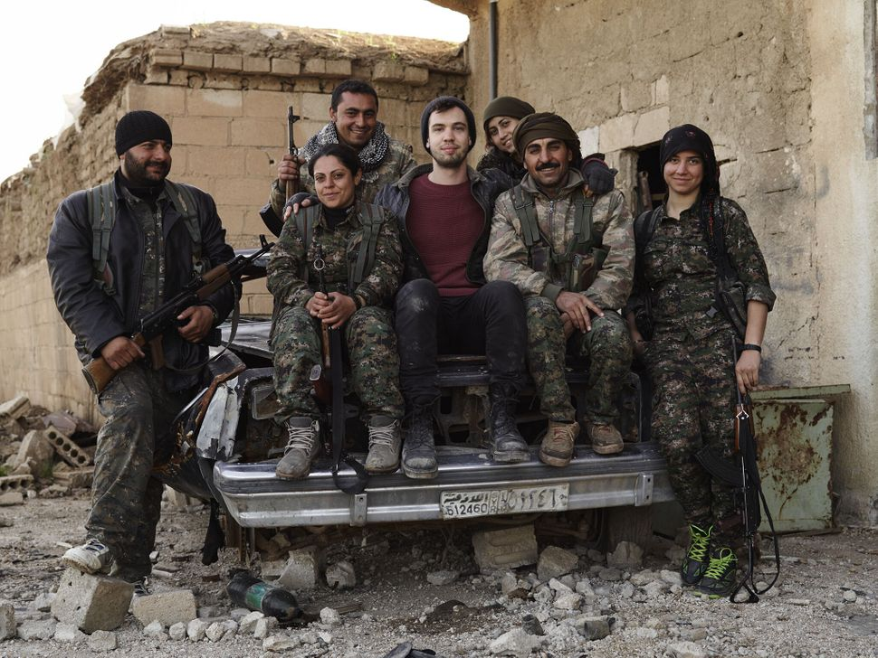 Joey L. with members of the YPG/J in Tel Hamis, Syria.