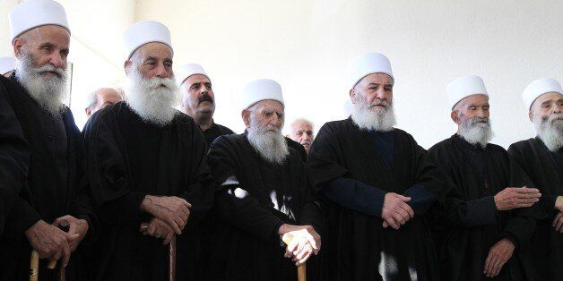 Druze sheikhs attend the funeral of Lebanese army First lieutenant Firas Mahmud al-Hakim, who was killed during clashes with