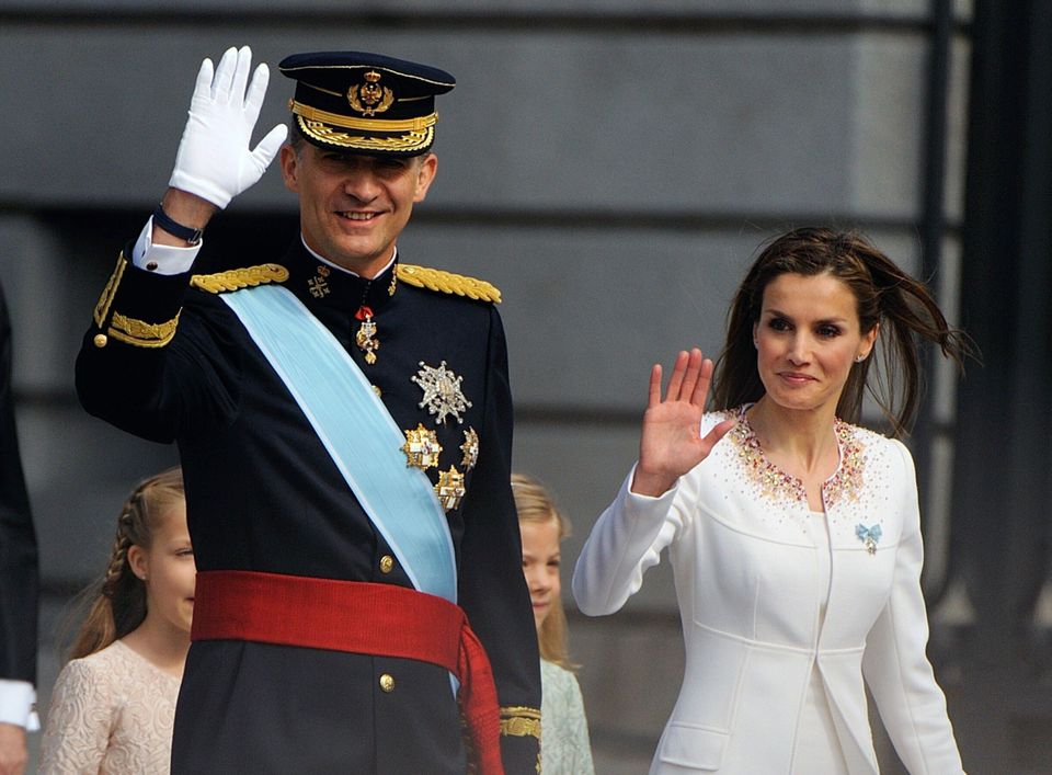 Spain's King Felipe VI and Queen Letizia arrive at the Congress of Deputies, Spain's lower House in Madrid on June 19, 2014 f