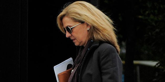 FILE - In this April 5, 2013 file photo, Spain's Princess Cristina as she walks toward her office in Barcelona, Spain. Spainâ