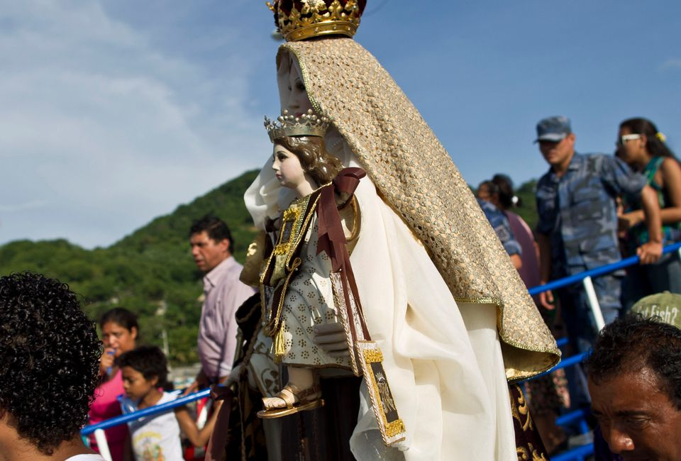 A statue of the Virgin of Carmen is carried to the start of a procession at the port of San Juan del Sur, Nicaragua, Tuesday,