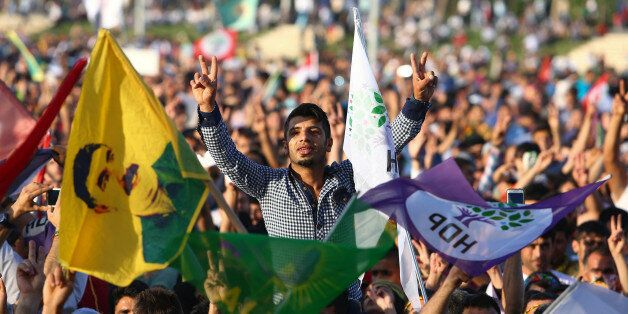DIYARBAKIR, TURKEY - JUNE 8: Supporters of the Pro-Kurdish Peoples' Democratic Party (HDP) wave flags with a picture of the j