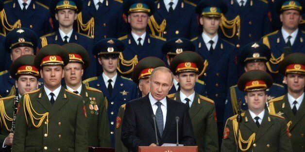 Russian President Vladimir Putin delivers a speech at the opening of the Army-2015 international military forum in Kubinka, o