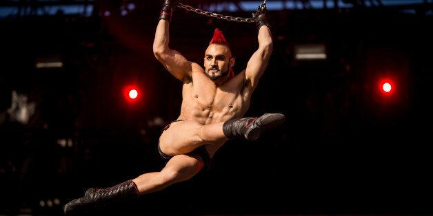 LAS VEGAS, NV - MAY 08:  A Cirque du Soleil cast member performs during Rock in Rio USA at the MGM Resorts Festival Grounds o