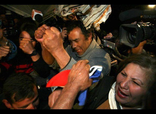 Alfonso Avalos(C) father of Chilean miner Florencio Avalos celebrates after Florencio was brought to the surface.