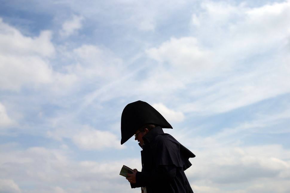 A man reads in a re-enactment of the Battle of Waterloo in Braine l'Alleud, Belgium, on June 18, 2015.