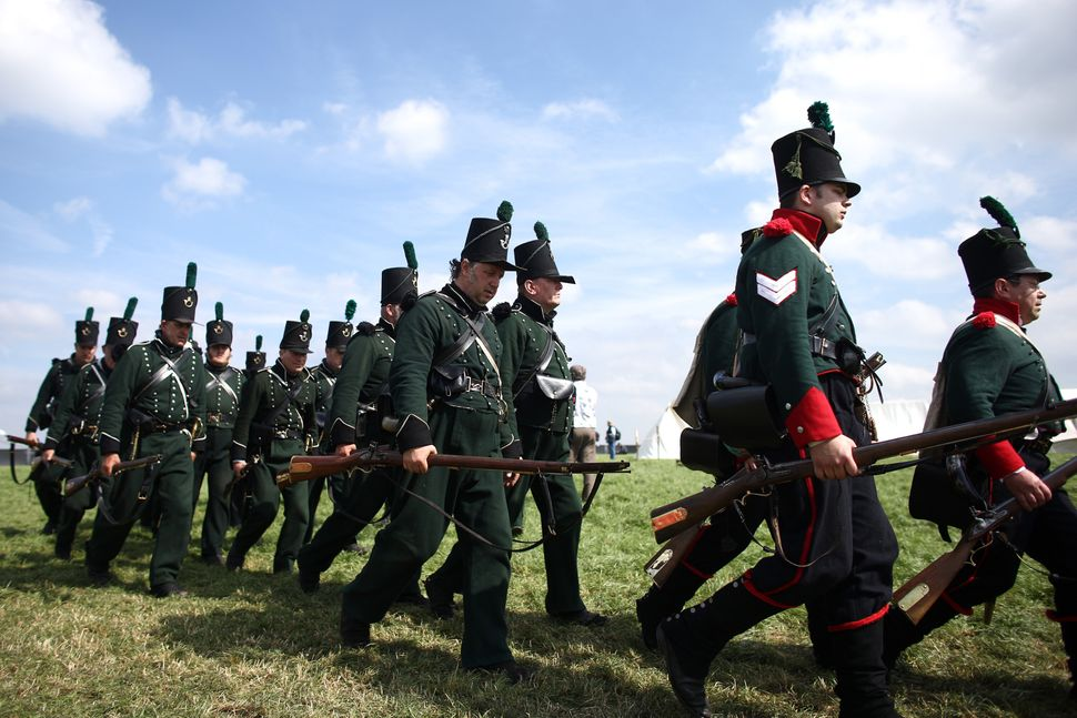 Men gather and march in a re-enactment of the Battle of Waterloo in Braine l'Alleud, Belgium, on June 18, 2015.