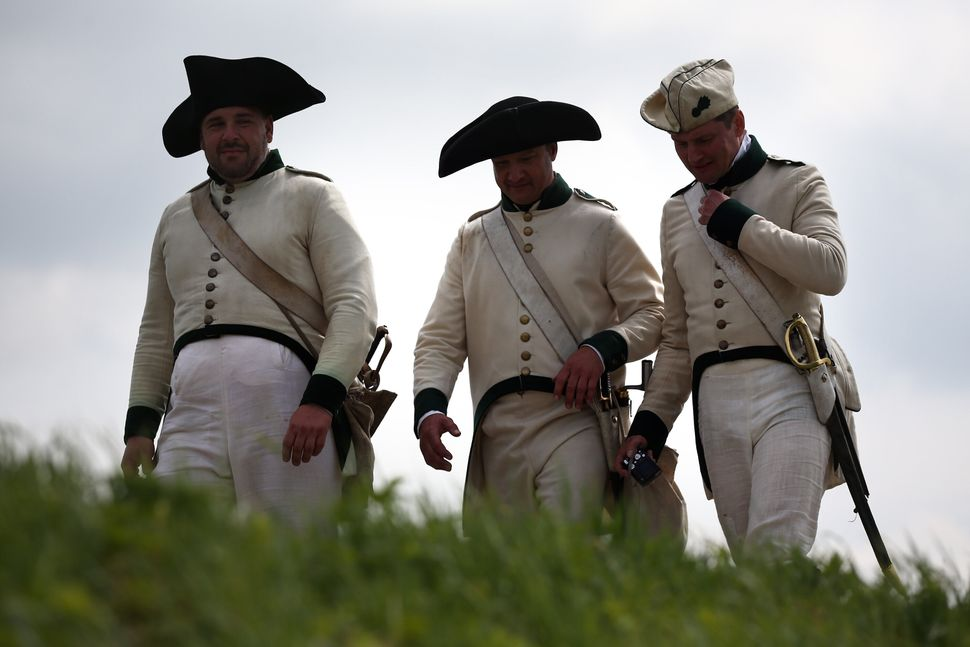 Men walk in a re-enactment of the Battle of Waterloo in Braine l'Alleud, Belgium, on June 18, 2015.