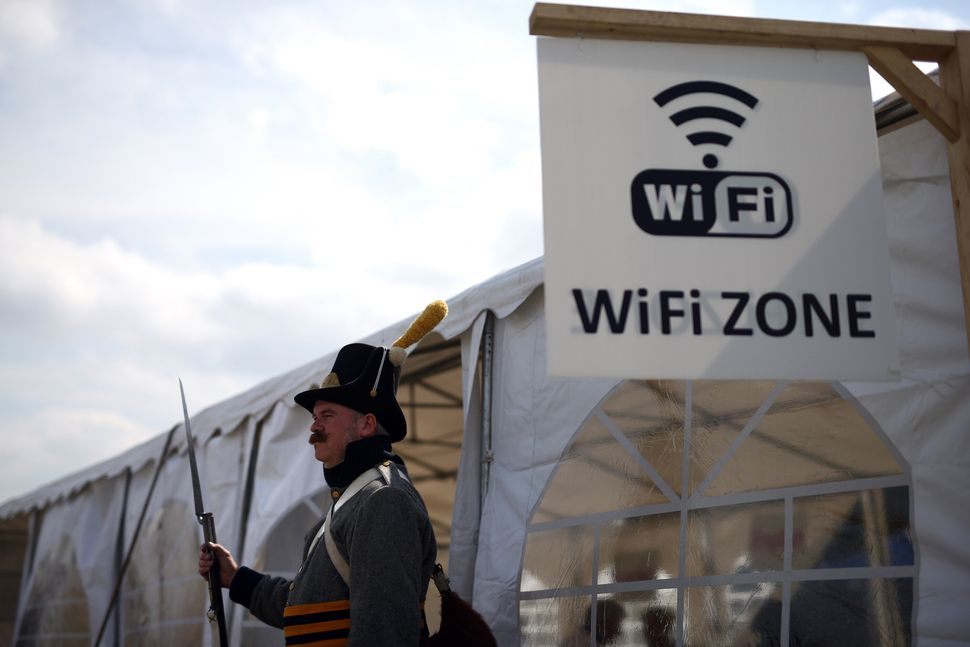 A man stands outside the wifi tent in a re-enactment of the Battle of Waterloo in Braine l'Alleud, Belgium, on June 18, 2015.