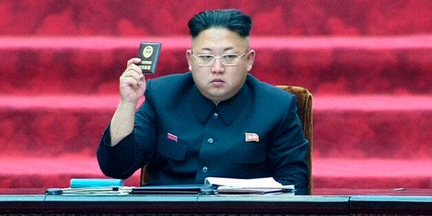 FILE - In this April 9, 2014, file photo made from video, North Korean leader Kim Jong Un holds up a parliament membership ce
