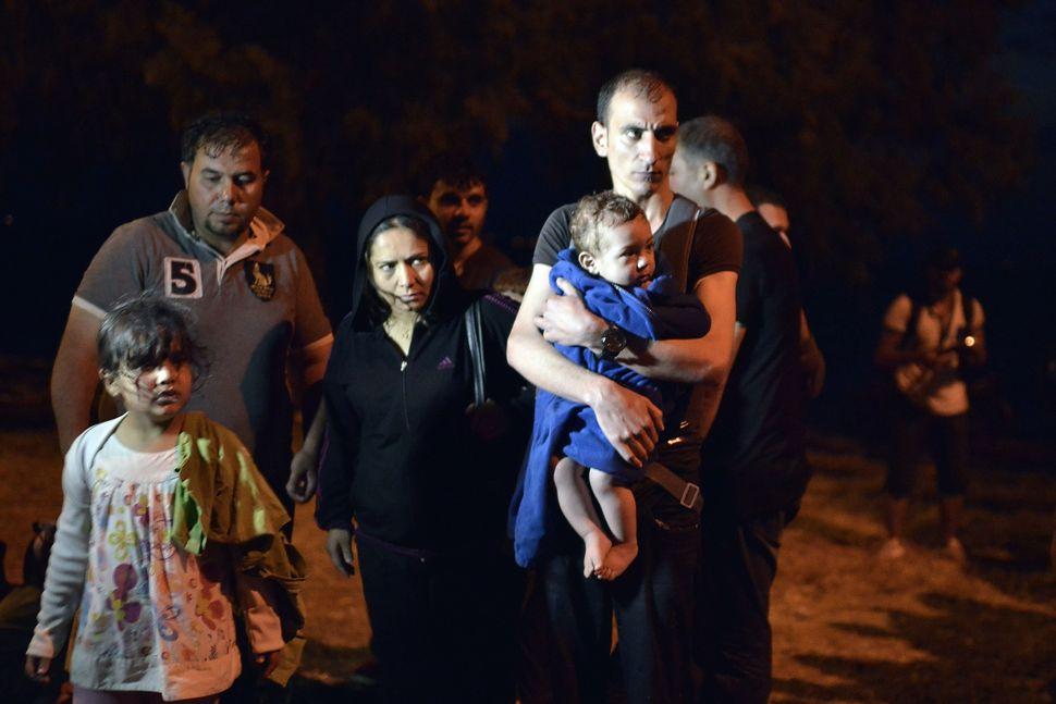 Syrian refugees arrive at Lesbos on June 18, 2015.
