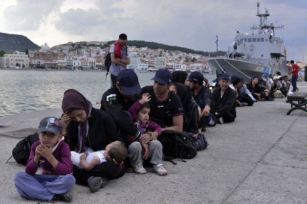 Migrants wait to be registered at Lesbos on June 18, 2015.