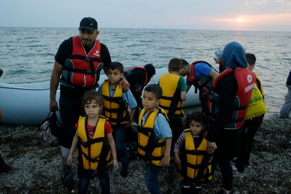Syrian migrants arrive at Lesbos by dinghy on June 18, 2015.