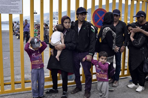 A migrant family waits to be registered at Lesbos on June 18, 2015.