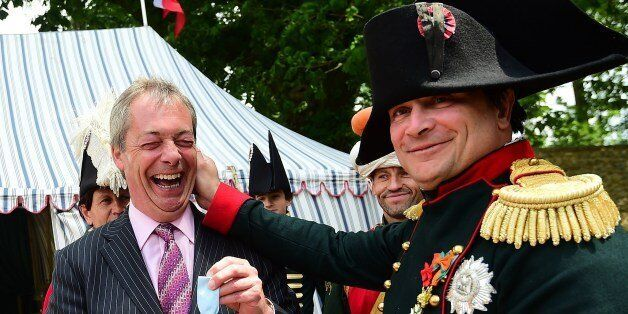 French lawyer Franck Samson, dressed as Napoleon Bonaparte (R) pulls the ear of UK Independence Party (UKIP) leader Nigel Far