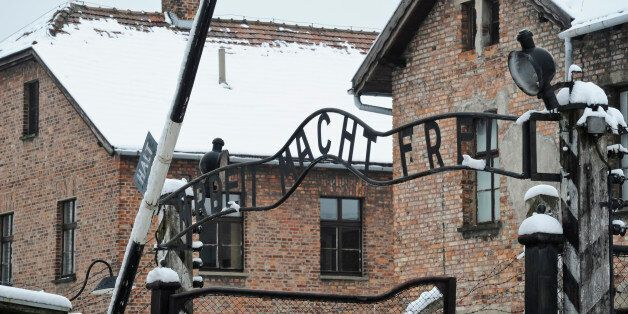 """The """"Arbeit Macht Frei"""" (Work Sets you Free) sign above the entrance gate of the Auschwitz Nazi death camp, is backdropped by"""