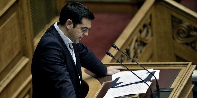 Greek Prime Minister Alexis Tsipras delivers a speech during a parliamentary session in Athens on June 28, 2015. Greece will