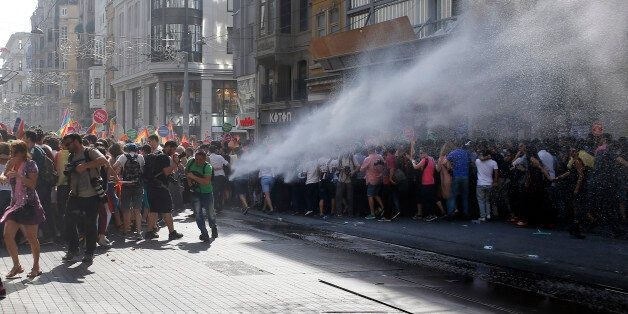 Turkish police use a water canon to disperse participants of a Gay Pride event in support of  Lesbian, Gay, Bisexual and Tran