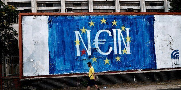 A man walks past a graffitti with a EU flag reading in German 'NO' concerning Greece's referendum on the latest offer of a de