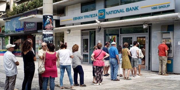 ATHENS, GREECE - JUNE 28:  Greeks queue in front of the National Bank to use ATM to withdraw cash on June 28, 2015 in Athens,