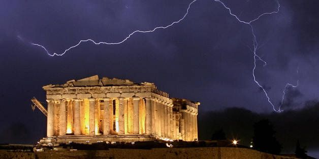 Athens, GREECE:  The ancient Greek Parthenon temple, atop the Acropolis hill overlooking Athens, is framed by a lightning bol