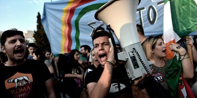 Protesters participate a demonstration in front of the Greek parliament in Athens on June 29, 2015. Greece shut its banks and
