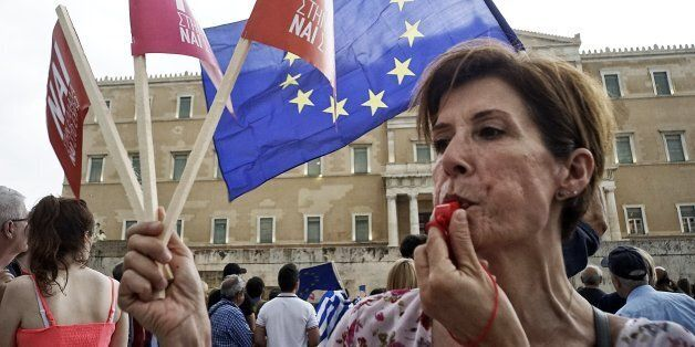 ATHENS, GREECE - JUNE 30: Demonstrators during a rally organized by supporters of the 'Yes' vote for the upcoming referendum