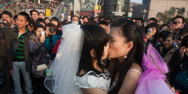 In a picture taken on March 8, 2011 a gay couple kiss during their ceremonial 'wedding' as they try to raise awareness of the