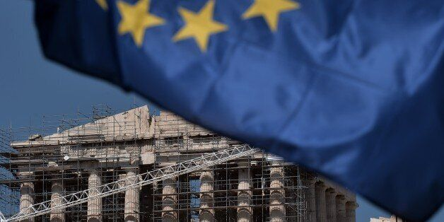 The Parthenon temple is seen behind an European Union flag in  in Athens on July 2, 2015. The Greek government led by Prime M