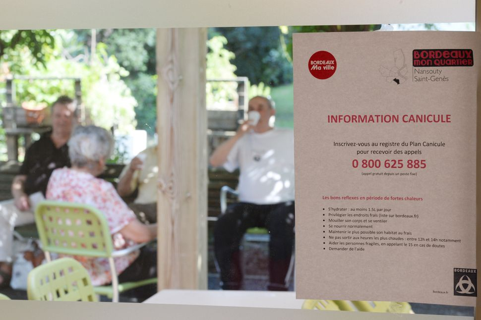 A notice at a home for elderly persons in Bordeaux, France, instructs residents on how to stay safe during the heat wave on T