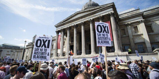An anti-austerity demonstrators attend a rally in Trafalgar Square in central London on July 4, 2015 in solidarity with those