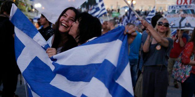 Supporters of the No vote react after the first results of the referendum at Syntagma square in Athens, Sunday, July 5, 2015.