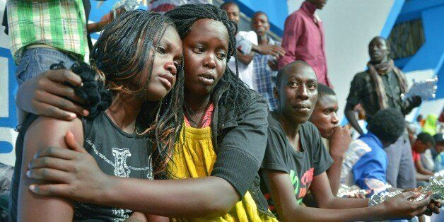 A survivor of an attack by islamist gunmen claimed by al-Shabab on a university campus in Garissa, northern Kenya is comforte
