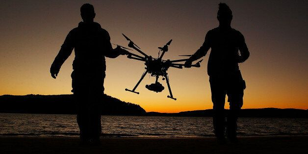 SYDNEY, AUSTRALIA - JULY 04:  Drone operator, Ken Butti and Camera operator, Robbie Josephsen carry the custom built DJI s100