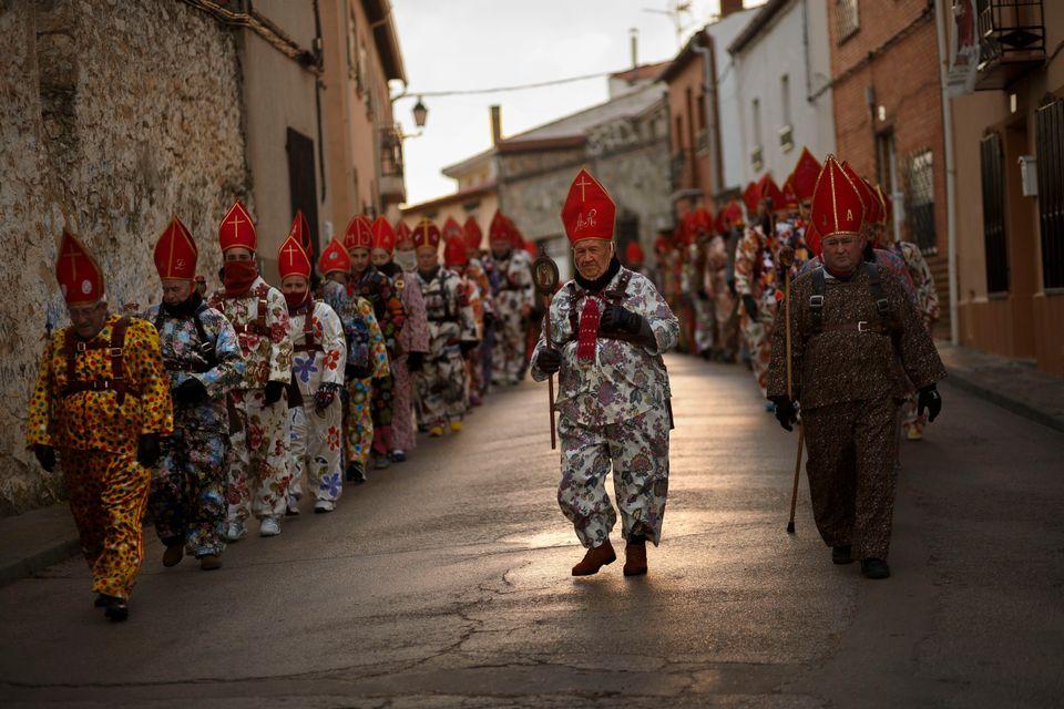 Aniceto Rodrigo, 78, Diablo Mayor or 'greater devil', center, leads the 'Endiablada' traditional festival  in Almonacid Del M