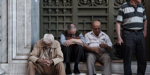 Pensioners wait outside a national bank brunch, as banks only opened for pensioners to allow them to get their pensions, with