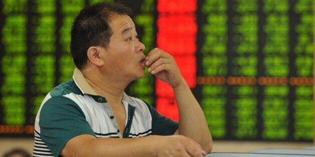 TO GO WITH China-economy-stocks, FOCUS by Fran Wang