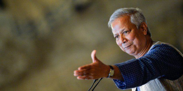 Bangladeshi Nobel Peace Prize winner and microcredit pioneer Muhammad Yunus gestures as he delivers a lecture entitled 'Socia