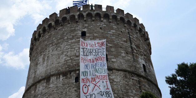 A banner hangs from the White Tower, a prominent landmark in the northern Greek city  of Thessaloniki on Saturday, June 27, 2