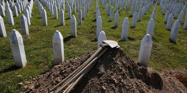 Shovels are stacked beside graves in Potocari near Srebrenica, 150 kms north east of Sarajevo, Bosnia, on Wednesday, July 8,2