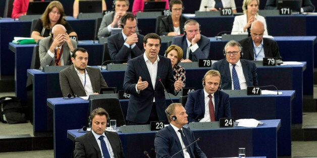 Greek Prime Minister Alexis Tsipras, standing at center, delivers hi speech at the European Parliament in Strasbourg, eastern